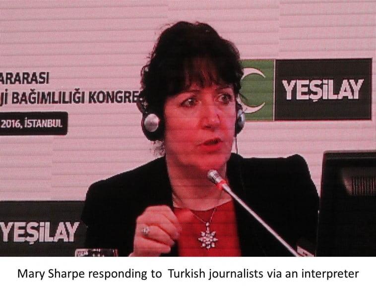 Mary Sharpe responding to Turkish journalists via an interpreter