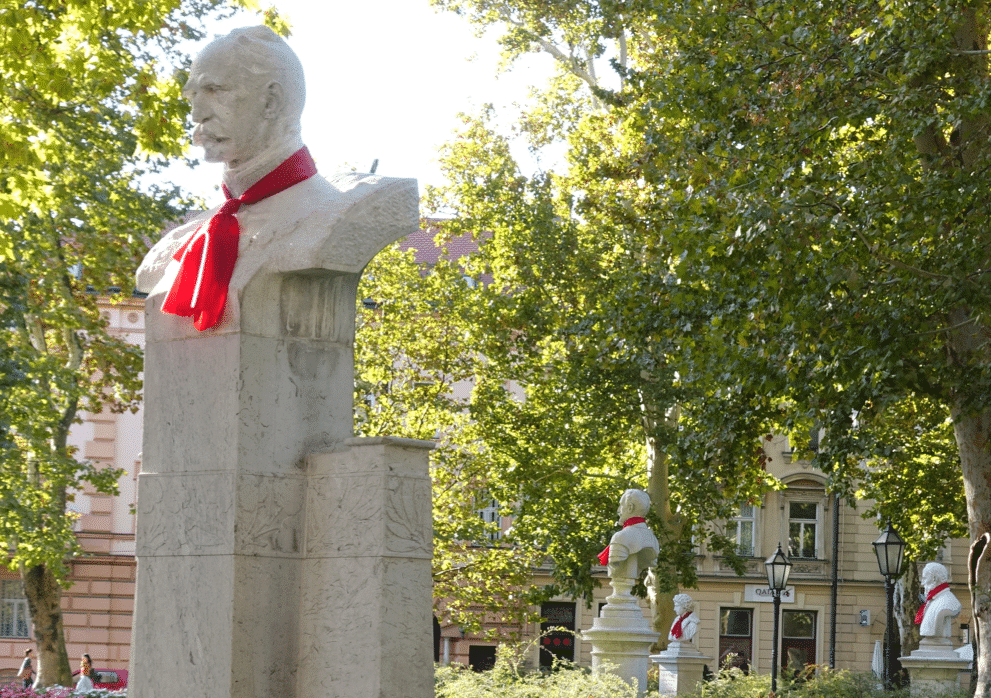 Statues in a park in Zagreb wearing ties